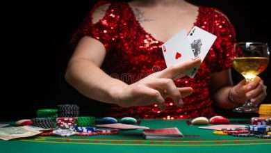 background casino girl evening red dress plays holds aces cards gambling business 158385223