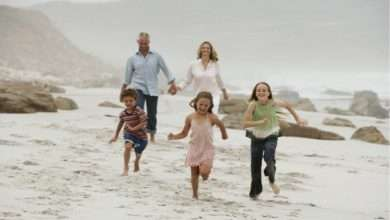 cheerful children running on beach living as family article